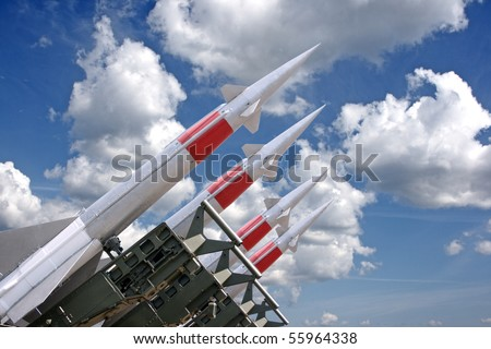 Four rockets of a surface-to-air missile system are aimed in the sky - stock photo