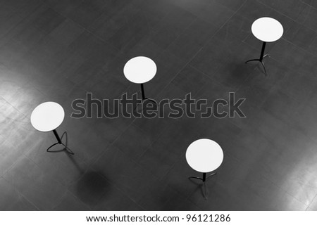 four round white tables seen from above - stock photo