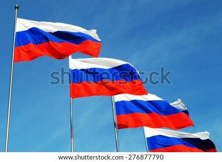 Four Russian flags in sunny day