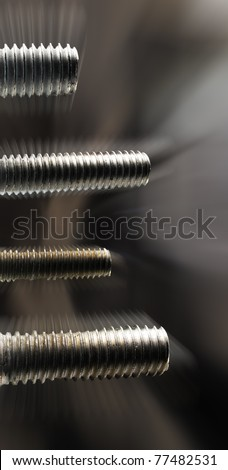 Four screws of different sizes with movement in vertical