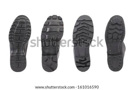 Four shoe sole in row. Whole background. - stock photo