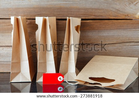 four shopping bags and one with a price tag - stock photo
