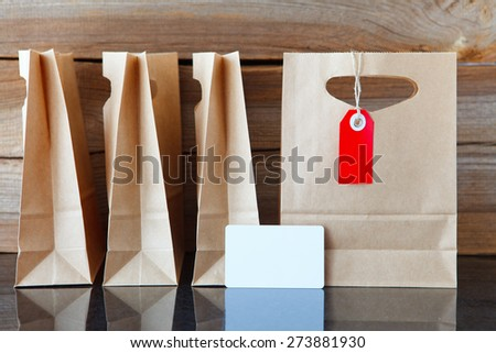 four shopping bags and one with a price tag and a blank credit card in front - stock photo