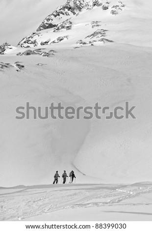 four skier on the background of mountains - Kaprun, Austria - stock photo