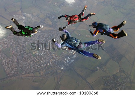 Four Skydivers - stock photo