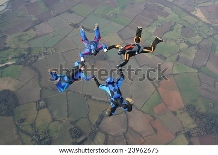 Four skydivers in a start formation - stock photo