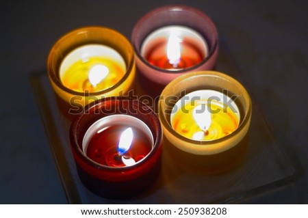four small burning candles - stock photo