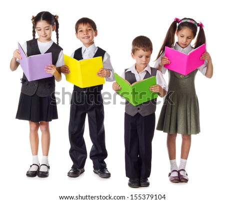 Four smiling schoolchild standing with colorful books, isolated on white - stock photo