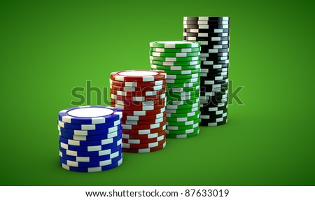 four stacks of gambling chips on green background