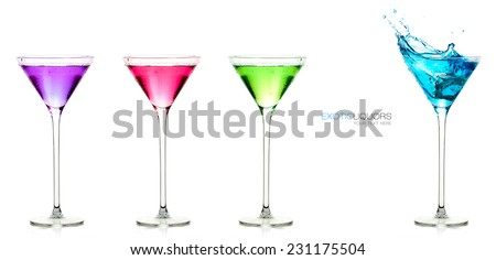 Four stemmed cocktail glasses full of different colored alcoholic drinks with the blue one splashing out, close-up, with sample text. Template design isolated on white. - stock photo