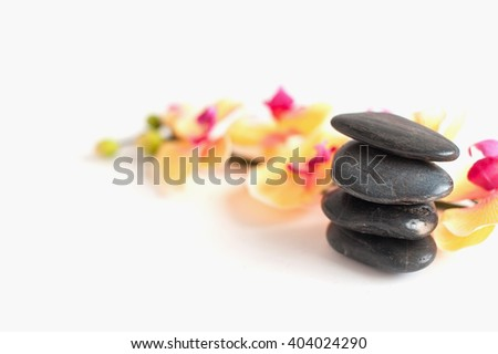 four stones for Spa treatments and Orchid flowers on white background - stock photo