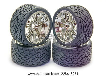 Four street tyres for a radio controlled car - stock photo