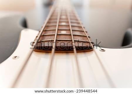 Four string bass guitar fingerboard close-up. selective focus image - stock photo
