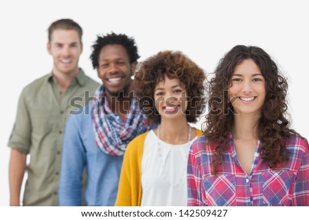 Four stylish friends standing in a line on white background