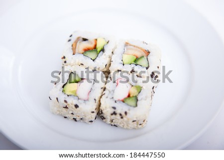 Four sushi pieces on a white plate - stock photo