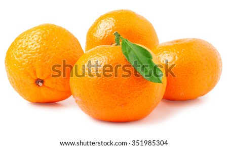 four tangerine with leaf on a white background. - stock photo