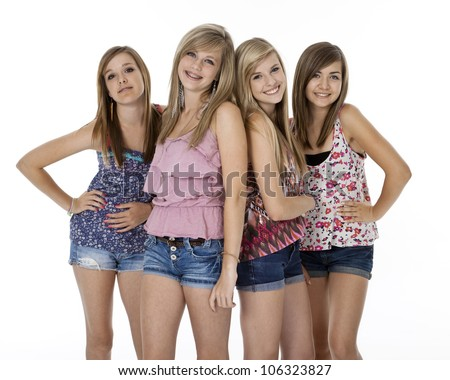 Four teenage girls in summer clothes standing, isolated on white.