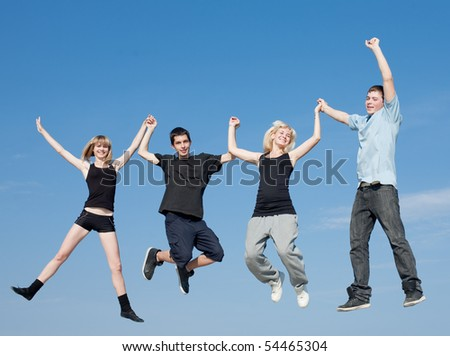 Four teenagers jumping on background of sky