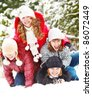 Four teenagers playing in snow - stock photo