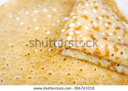 Four times folded pancake with sour cream closeup
