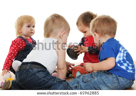 Four toddlers are playing with yarn and buttons; isolated on the white background