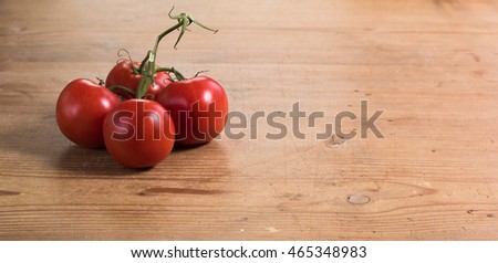 Four tomatoes on the Table
