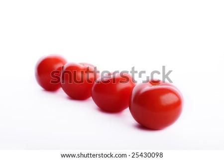 Four tomatos in a row - stock photo