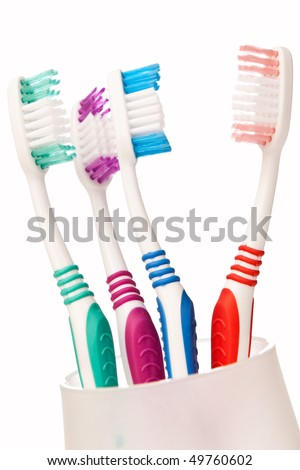 Four tooth brushes, closeup isolated on white