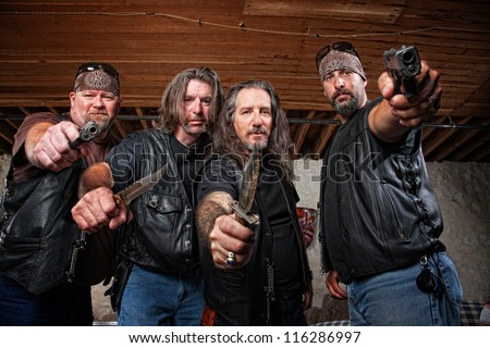 Four tough middle aged white gang members with weapons