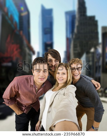 Four tourists taking a selfie during a city trip in a big city (Manhattan, New York)                                 - stock photo