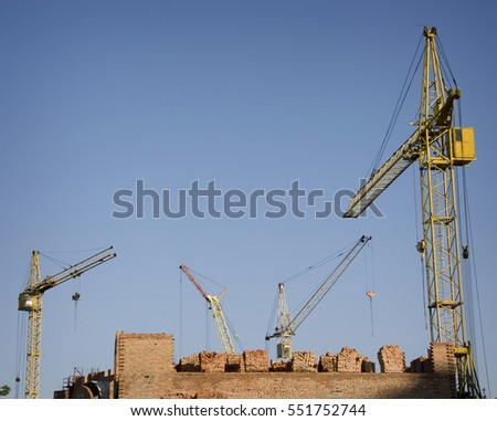 Four tower cranes around buildings