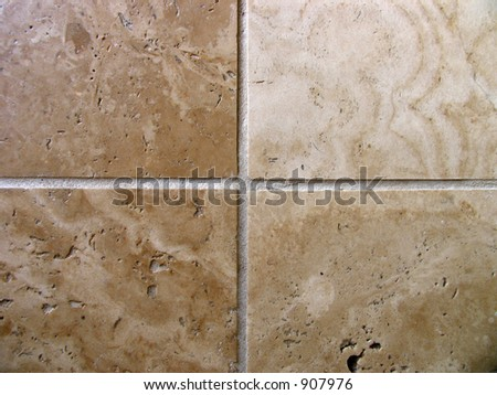 four travertine tiles lovely background and great for showing natural differences in colour