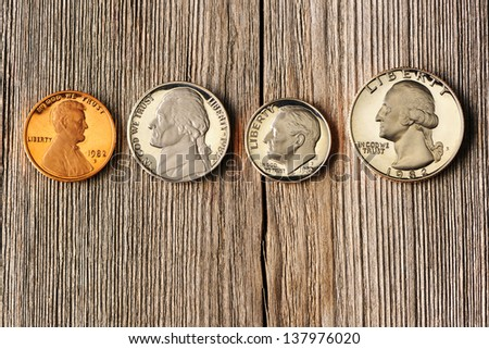 Four US cent coins over wooden background - stock photo