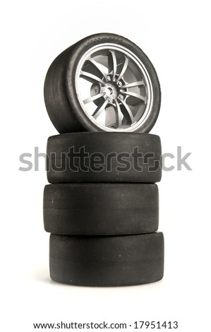Four used race tires on light background