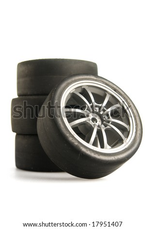 Four used race tires on white background