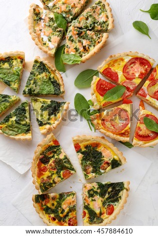 Four vegetables quiche top view. Food