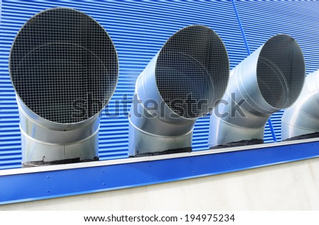 four ventilation pipes of industrial building, horizontal - stock photo