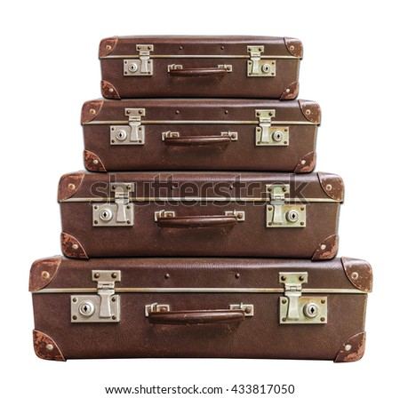 Four vintage brown suitcase on white background