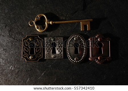 Four vintage locks with a gold key