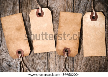 Four Vintage Paper Label With Shadow on Wood Background - stock photo