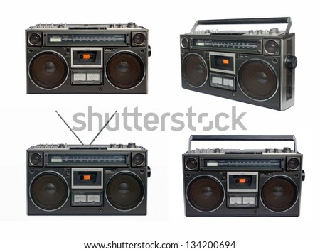 Four vintage radio cassette recorders, isolated on white - stock photo