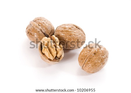 Four walnuts close-up on white background - stock photo