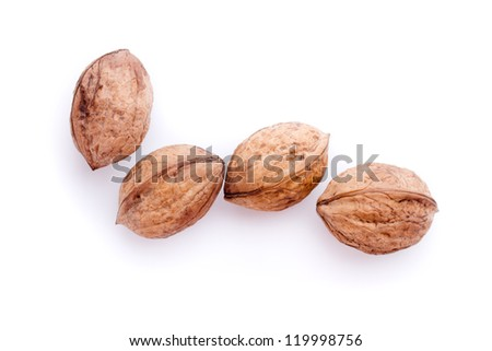 four walnuts - isolated on a white background