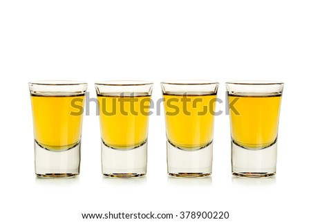 four whiskey shots isolated on white
