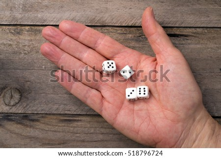 Four white dice on black background