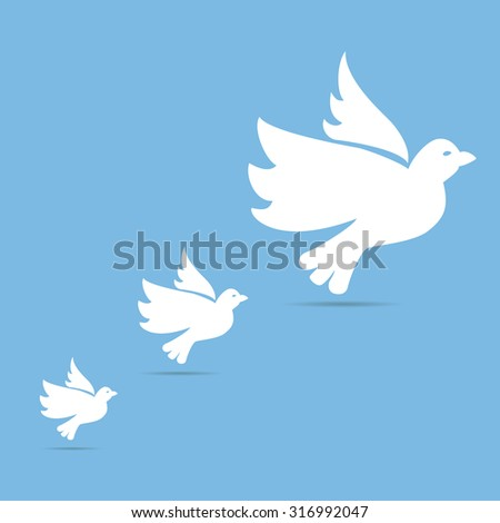 Four white doves of peace flying up