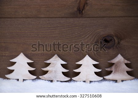 Four White Wooden Christmas Trees On Snow Symbolizing Advent. Christmas Decoration Or Christmas Card. Brown, Rustic, Vintage Background With Copy Space For Advertisement Or Seasons Greetings. - stock photo