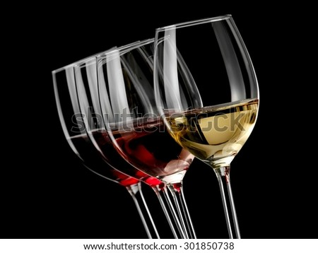Four wine glasses with wine on black background