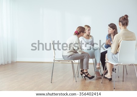 Four women talking in group about problems - stock photo