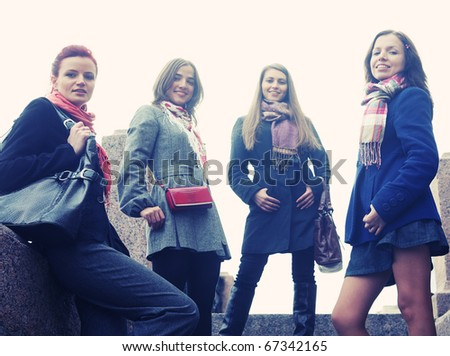 four women walking along the street together